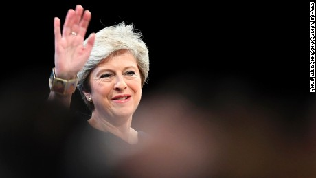 Britain's Prime Minister Theresa May waves as she takes the stage to deliver her speech on the final day of the Conservative Party annual conference at the Manchester Central Convention Centre in Manchester, northwest England, on October 4, 2017. / AFP PHOTO / Paul ELLIS        (Photo credit should read PAUL ELLIS/AFP/Getty Images)