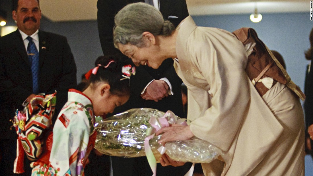 Ayaka Tazumi, 5, presents flowers to Empress Michiko of Japan as she and Emperor Akihito prepare to leave the Japanese Canadian Cultural Center in Toronto on July 9, 2009.
