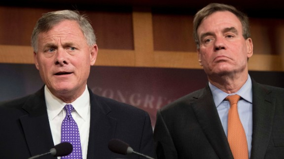 Senate Intelligence Chairman Richard Burr, at left, a North Carolina Republican; and Senate Intelligence Vice Chairman Mark Warner, at right, a Virginia Democrat, hold a news conference on the status of the committee's inquiry into Russian interference in the 2016 election on Capitol Hill in Washington in October 2017. (JIM WATSON/AFP/Getty Images)