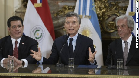 Argentine President Mauricio Macri (C) speaks to the press next to his counterparts Horacio Cartes (L) of Paraguay and Tabare Vazquez of Uruguay after holding a meeting at the Casa Rosada presidential palace in Buenos Aires on October 4, 2017. Argentina, Uruguay and Paraguay announced thier joint bid to organize the 2030 World Cup.  / AFP PHOTO / Juan MABROMATA        (Photo credit should read JUAN MABROMATA/AFP/Getty Images)
