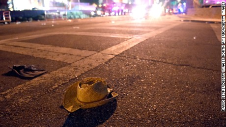 Wallets, clothing and hats of those who fled lined the streets of the Las Vegas Strip.