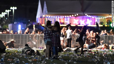 LAS VEGAS, NV - OCTOBER 01:  People run from the Route 91 Harvest country music festival after apparent gun fire was heard on October 1, 2017 in Las Vegas, Nevada. There are reports of an active shooter around the Mandalay Bay Resort and Casino.  (Photo by David Becker/Getty Images)