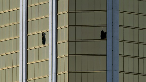 The damaged windows on the 32nd floor room that was used by the shooter in the Mandalay Hotel