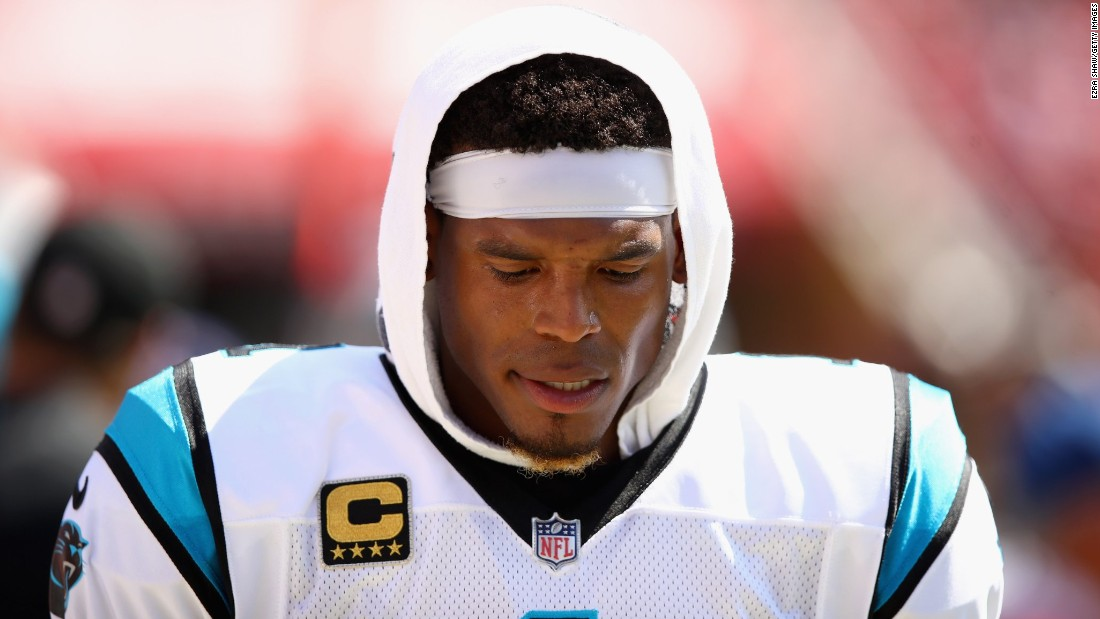 A bystander says Cam Newton offered $1,500 to trade seats with another passenger. He was rejected