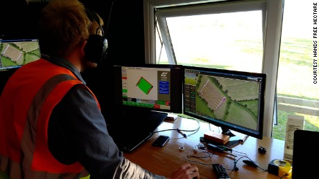 Engineer Martin Abell monitors an automated spraying operation from the control room.