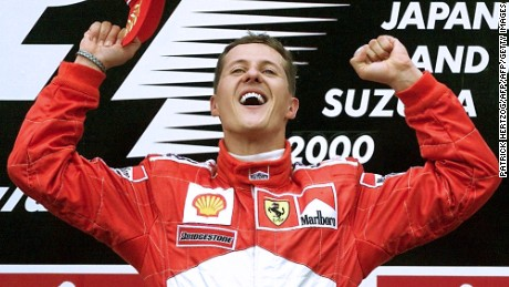 Michael Schumacher celebrates on the podium after winning the 2000 Japanese GP