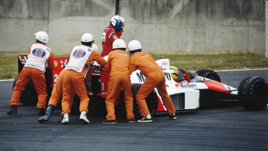 Senna (closest to the camera) managed to get going again and take the checkered flag in the race but was later disqualified for using the chicane's escape road to rejoin the circuit. The result meant Prost won the drivers' title that year.