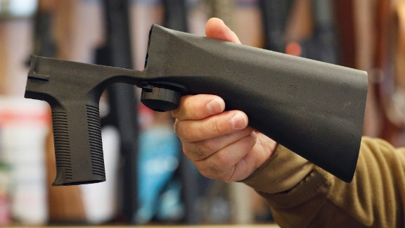 A bump stock device that fits on a semi-automatic rifle to increase the firing speed, making it similar to a fully automatic rifle, is shown here at a gun store in Salt Lake City, Utah.