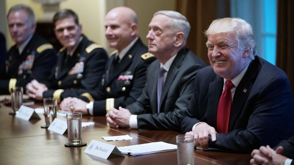 US President Donald Trump smiles as Defense Secretary James Mattis (2L) looks on during a meeting with senior military leaders in the Cabinet Room of the White House on October 5, 2017.