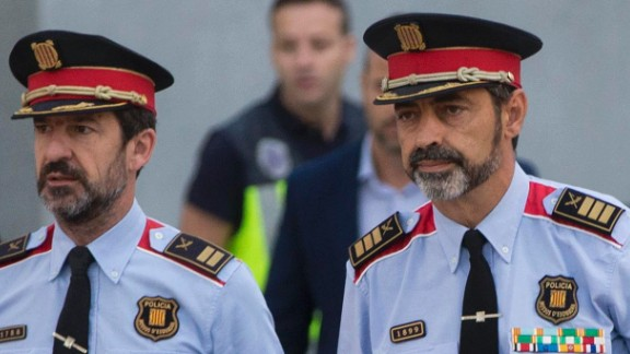 Catalan regional police chief Josep Lluis Trapero, 2nd right, arrives at the national court in Madrid on Friday.