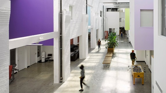Originally a 1930s waterworks warehouse, this building was converted into a center for homeless youth in Toronto by LGA  Architectural Partners.