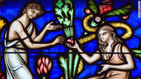 BRUSSELS, BELGIUM - JULY 26, 2012: Adam and Eve eating the Forbidden Fruit in the Garden of Eden on a stained glass window in the cathedral of Brussels. ; Shutterstock ID 390750319; Job: -