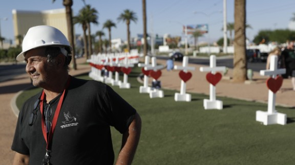 Greg Zanis stands in front of crosses he placed near the city's famous sign Thursday, Oct. 5, 2017, in Las Vegas. The crosses are in honor of those killed when Stephen Craig Paddock broke windows on the Mandalay Bay resort and casino and began firing with a cache of weapons onto a country music festival Sunday. Dozens of people were killed and hundreds were injured. (AP Photo/Gregory Bull)
