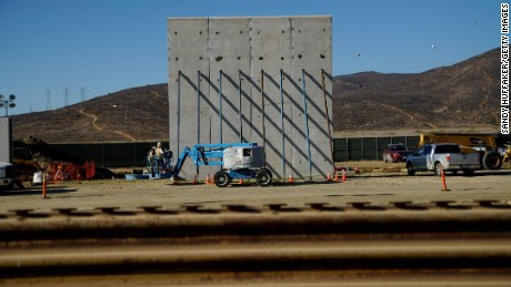 TIJUANA, MEXICO - OCTOBER 5:  Prototype sections of a border wall between Mexico and the United States are under construction on October 5, 2017 in Tijuana, Mexico. Prototypes of the border wall propopsed by President Donald Trump are being built just north of the U.S.- Mexico border, where competitors who are hoping to gain approval to build the wall have until the first of next month to complete their work. (Photo by Sandy Huffaker/Getty Images)