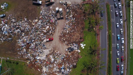 Debris and garbage produced by the passing of Hurricane Maria are dumped in a field in Toa Baja, Puerto Rico on October 6, 2017.  / AFP PHOTO / Ricardo ARDUENGO        (Photo credit should read RICARDO ARDUENGO/AFP/Getty Images)
