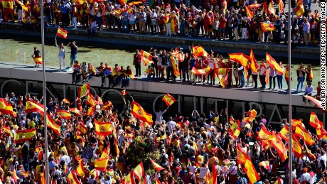 Protesters with Spanish flags gather Saturday in Madrid to demonstrate against Catalan independence.