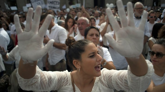"""A woman takes part in the """"Let's Talk"""" protest in Barcelona to call for dialogue on Saturday."""
