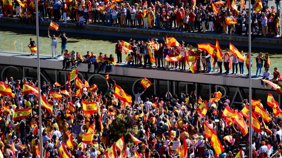 Protesters with Spanish flags gather to demonstrate against independence for Catalonia in Madrid on October 7.