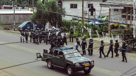 Cameroon police officials with riot equipment patrol in Buea, in Cameroon's Southwest Region, on October 1, 2017.