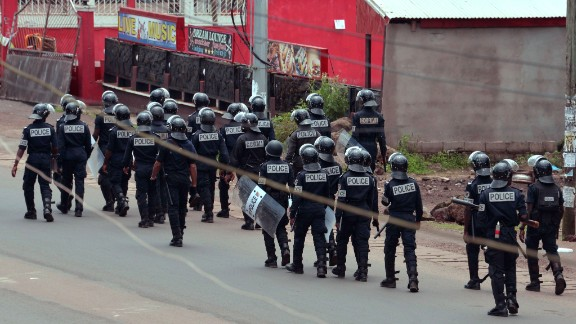 Cameroon police with riot shields patrol on a street in the administrative quarter of Buea on October 1, 2017.