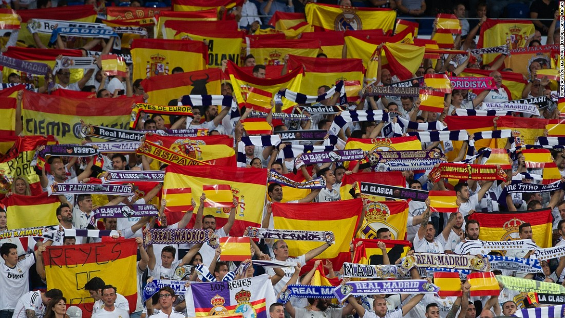 Real Madrid fans wave Spanish flags during the La Liga match between Real Madrid and Espanyol to show their opposition to the Catalonia independence referendum on the same day.