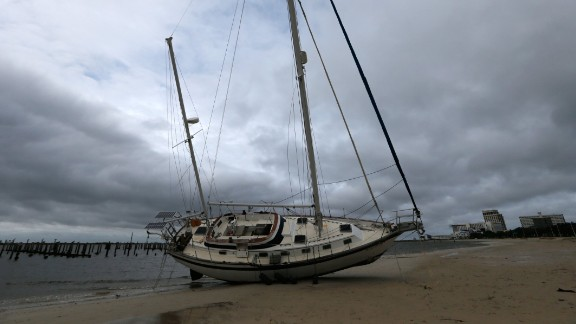 A sailboat is seen after it was washed ashore in Biloxi, Mississippi, during Hurricane Nate on Sunday, October 8, 2017.