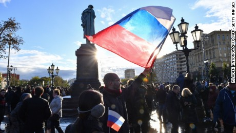 Demonstrators gather by a statue of poet Alexander Pushkin in an anti-Putin rally in Moscow on Saturday.