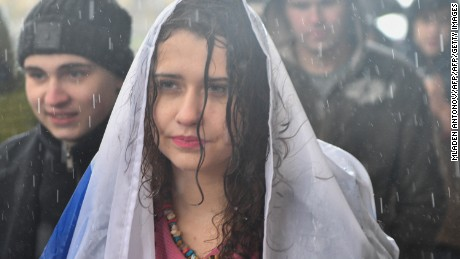 A woman protesting in the rain Saturday in support of jailed activist Alexei Navalny.