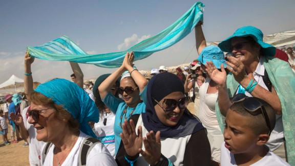 Palestinian and Israeli women take part in a peace march near the Dead Sea.