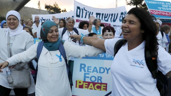 Palestinian and Israeli activists march in the heart of Jerusalem demanding a Mideast peace deal.