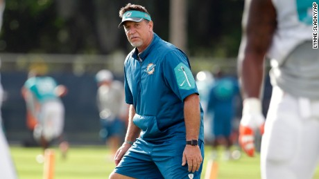 Miami Dolphins offensive line coach Chris Foerster watches as players do drills during a training camp in Davie, Florida.