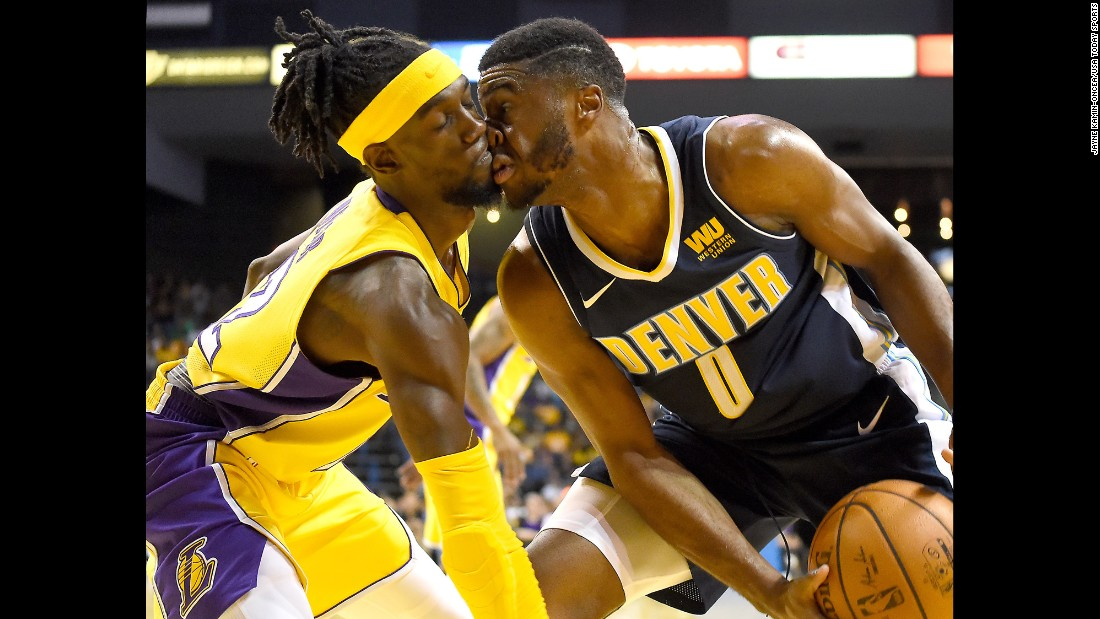 Los Angeles Lakers guard Briante Weber, left, collides with Denver Nuggets guard Emmanuel Mudiay during the second half of the game on Wednesday, October 4.