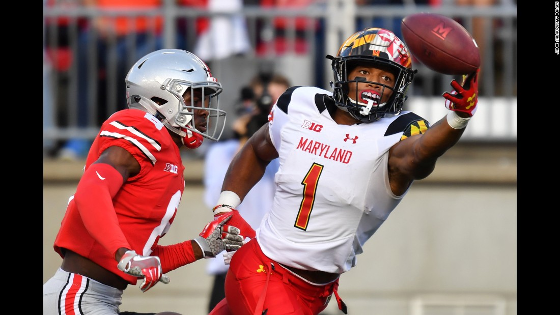 D.J. Moore of the Maryland Terrapins reaches but misses the catch on a fourth down pass attempt in front of Kendall Sheffield of the Ohio State Buckeyes on Saturday, October 7, in Columbus, Ohio.