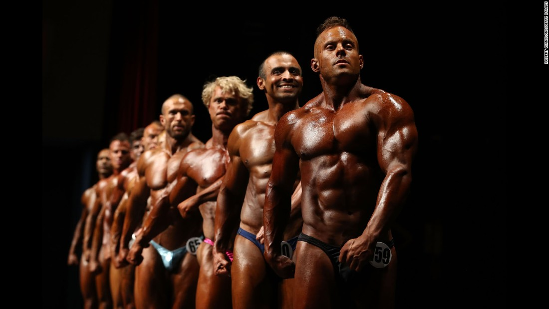 Competitors pose on stage during the Victorian Bodybuilding Championship on Sunday, October 8, in Melbourne, Australia.