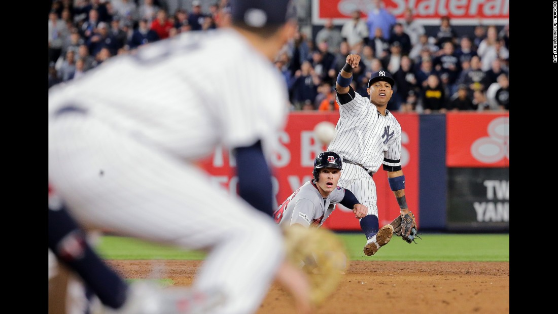 New York Yankees second baseman Starlin Castro, right, tries to throw to first baseman Greg Bird, left, for the double-play after forcing out Minnesota Twins right fielder Max Kepler. The Yankees defeated the Twins 8-4 during the 2017 MLB Playoffs American League Wild Card Game on Tuesday, October 3.