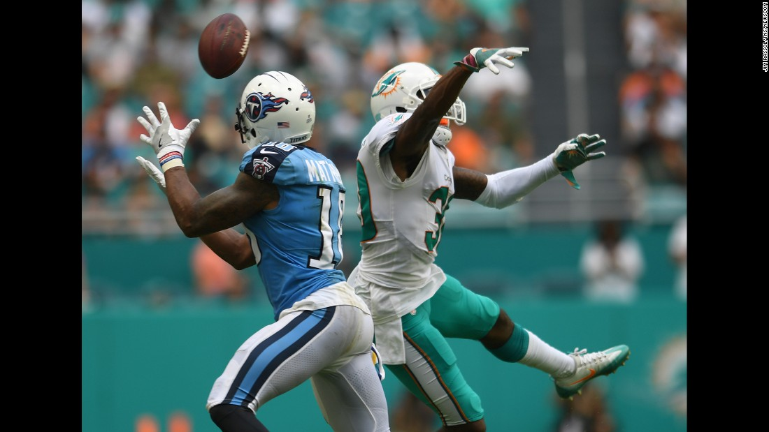 "Miami Dolphins cornerback Cordrea Tankersley, right, deflects a pass intended for Tennessee Titans wide receiver Rishard Matthews on Sunday, October 8. The Dolphins won, 16-10. <a href=""http://www.cnn.com/2017/10/09/sport/miami-dolphins-ol-coach-resigns/index.html"" target=""_blank"">Miami Dolphins' offensive line coach resigns</a>"