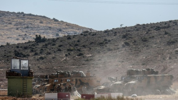 Turkish army armored vehicles and soldiers at the country's border with Syria in Hatay on Sunday.