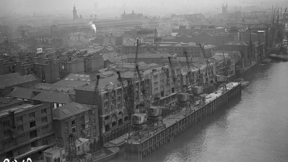 A view of London from Tower Bridge shows warehouses in 1982.
