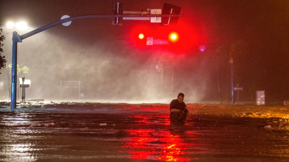 BILOXI,MS-OCTOBER 8, 2017:  Lanny Dean, from Tulsa, Oklahoma, takes video as he wades along a flooded Beach Boulevard next to Harrahs Casino as the eye of Hurricane Nate pushes ashore in Biloxi, Mississippi October 8, 2017.  Hurricane Nate flooded the parking garage and first floors of Golden Nugget, Harrahs and other casinos as it made a second landfall on the Mississippi coast as a category 1 storm. (Photo by Mark Wallheiser/Getty Images)