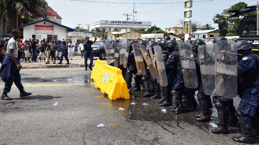 Liberian anti-riot policemen take part in an exercise in Monrovia on October 9, 2017, on the eve of the country's presidential elections. Liberians go to the polls on October 10, 2017, to pick their first new president in 12 years as Ellen Johnson Sirleaf closes the page on two terms dominated by post-war reconstruction and the Ebola crisis.