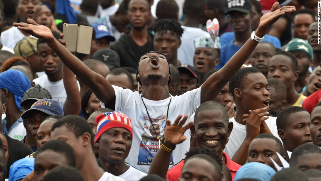 A man gestures as former international Liberian football star turned politician, George Weah supporters attend a presidential campaign rally in Monrovia on October 6, 2017.
