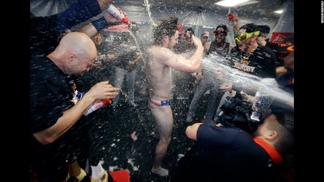 Houston Astros' Josh Reddick is sprayed with champagne after the team defeated the Boston Red Sox 5-4 in Game 4 of the American League Division Series on Monday, October 9 in Boston. The Astros advance to the American League Championship Series.