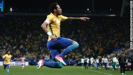 TOPSHOT - Brazil's forward Neymar celebrates after scoring against Paraguay during their 2018 FIFA World Cup qualifier football match in Sao Paulo, Brazil on March 28, 2017. / AFP PHOTO / Miguel SCHINCARIOL        (Photo credit should read MIGUEL SCHINCARIOL/AFP/Getty Images)