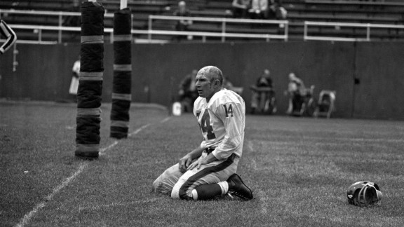 Hall of Fame football quarterback Y.A. Tittle died October 8 at the age of 90. Tittle made the Pro Bowl seven times over his 17-year career, and he was the NFL's MVP in 1963. In this photo, Tittle squats on the field after being hit hard during a game against the Pittsburgh Steelers in 1964. This became an iconic photograph that helped cement Tittle's name in football history.
