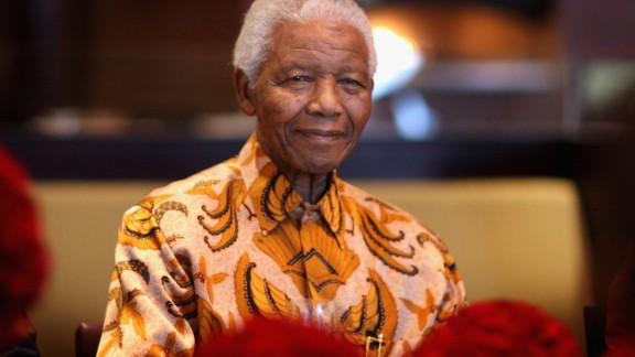 Nelson Mandela smiles during a lunch to Benefit the Mandela Children