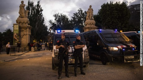 Officers of Catalonia's regional police force stand guard outside the Parliament of Catalonia.