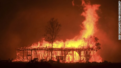 The Historic Round Barn burns, Monday October 9, 2017, in Santa Rosa, Calif. More than a dozen wildfires whipped by powerful winds been burning though California wine country. The flames have destroyed at least 1,500 homes and businesses and sent thousands of people fleeing.