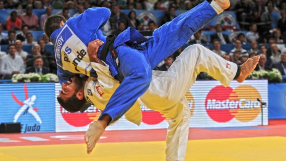 """""""I have been a judo fan all my life,"""" says Willingham. """"I was a volunteer at the Athens 2004 Olympics in the judo and watched Ilias Iliadis win Olympic gold at 17 years old (I was 16 at the time). So for me, it has been amazing to be able to document the ups and downs of his career so closely. He is one of the most spectacular judokas, when he's on the mat something extraordinary invariably happens! He is also one of my favorite judoka of all time. I have two shots of him that I particularly like. This is at the 2011 World Championships in Paris, which he would go on to win to become a double world champion. In the semifinal against one of his great rivals Kiril Denisov, he threw with this incredible Ura Nage for ippon to put him into the final."""""""