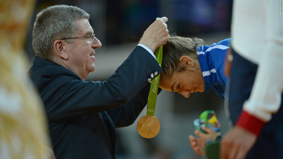 """The second shot I am proud of as it's IOC president Thomas Bach awarding Kelmendi her medal. Once again it's historic, but I also took a risk and snuck around to the side to see both of their faces and managed to find a gap between two of the medal hostesses to get the exact shot I wanted. This also meant I'm sure I'm the only person in the world with this image!"""