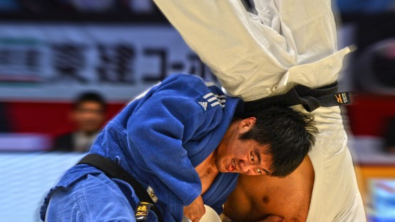 """""""This throw from the -90kg final of the 2012 Tokyo Grand Slam final by former world champion Lee Kyu Won against Masashi Nishiyama to me really shows how much drive with the legs Lee needs to finish the throw off. I love the expression on his face, I love the flailing arms of Nishiyama trying to scramble to avoid the inevitable, there's so much in this one. It is one my favorites on image alone but, for me, it holds a special place in my heart because 2012 was the first time I had ever been to Japan, the home of judo, and it was my first visit to the legendary Tokyo Grand Slam. So to come away with such a great shot made it all the more special."""""""